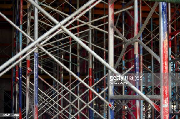 Metal scaffolding being used in the construction of a residential apartment building