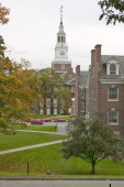 A metal sculpture stands in front of the Baker Tower on the campus of Dartmouth College in Hanover New Hampshire