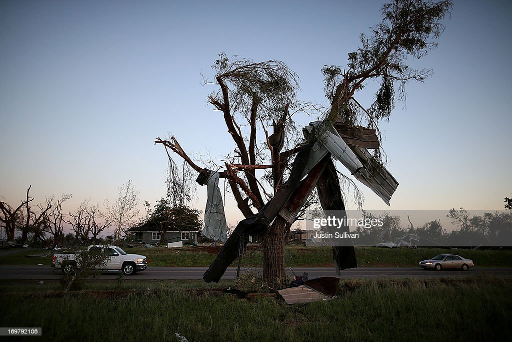 Metal siding hangs from a tree after a series of tornadoes ripped through the area a day earlier on June 1, 2013 in El Reno, Oklahoma. A series of tornadoes ripped through the area on Friday evening killing at least nine people, injuring many others and destroying homes and buildings.