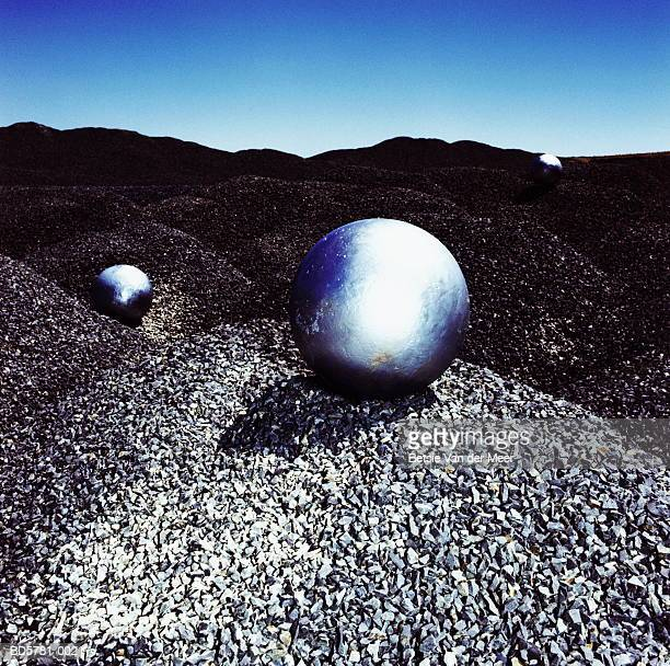 Metal spheres on gravel pit