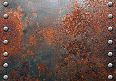 Rusty metal texture with rivets