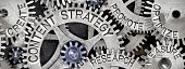 Macro photo of tooth wheel mechanism with CONTENT STRATEGY concept related words imprinted on metal surface