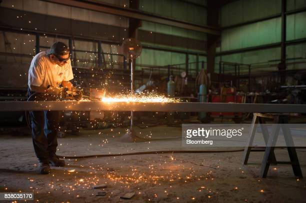 A metal worker preps steel for the base framework of a modular farming unit at the Modular Farms Co manufacturing facility in Cornwall Ontario Canada...