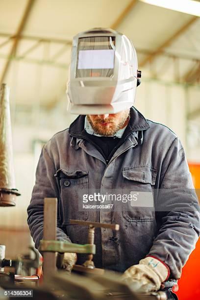 Metal Worker Working in factory