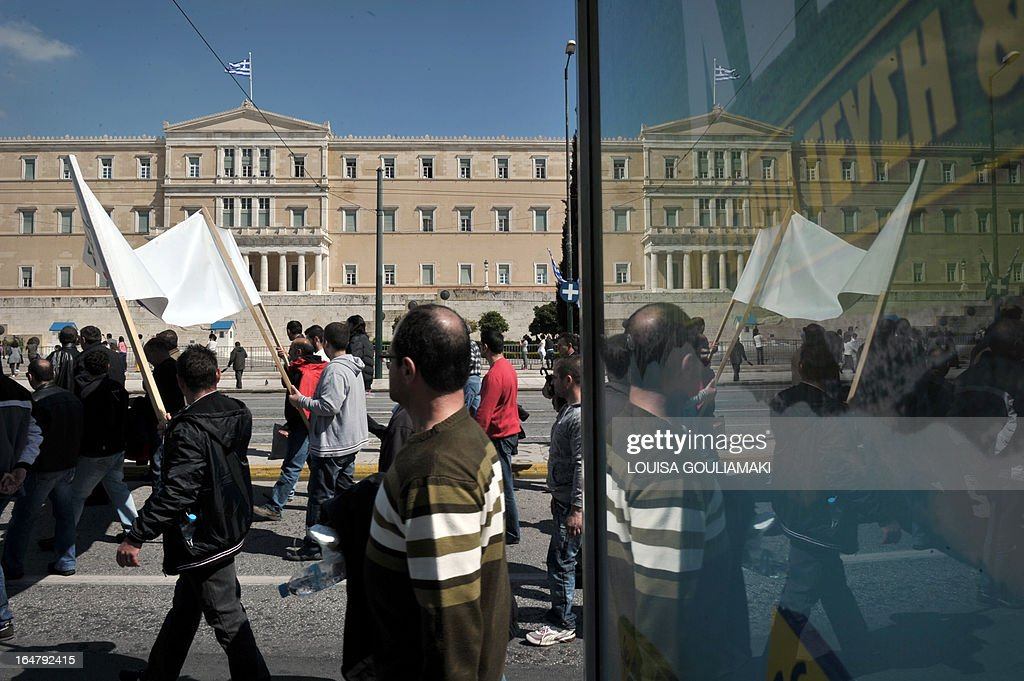 Metal workers march to protest the government's austerity measures and high unemployment in their sector, in front of the Greek parliament in central Athens on March 28, 2013. AFP PHOTO / LOUISA GOULIAMAKI