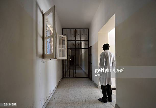 A metalbarred doors stands open in a hall of the Psychiatric hospital in Tripoli on August 28 2011 Tripoli's sole psychiatric hospital already unable...