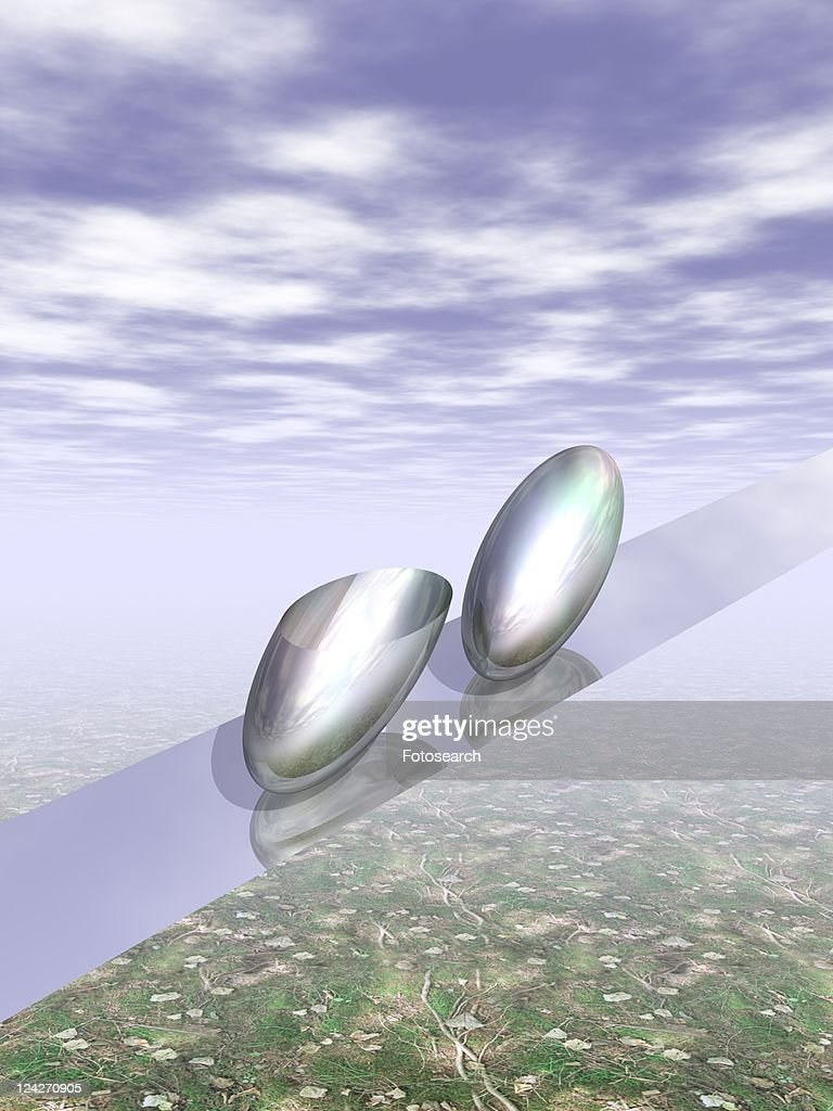 Metallic capsules on belt in the air