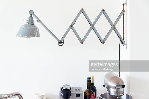 Metallic lamp over kitchen appliances