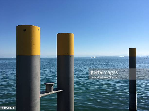 Metallic Pole At Lake Constance Against Clear Blue Sky