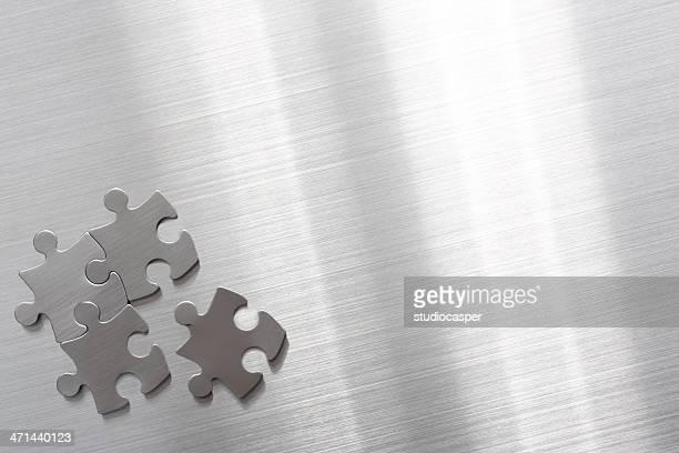 Metallic puzzle pieces