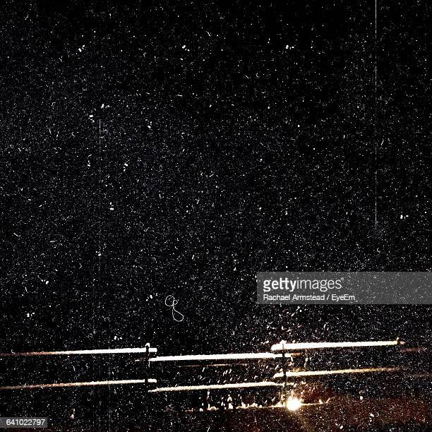 Metallic Railing At Night During Snowfall
