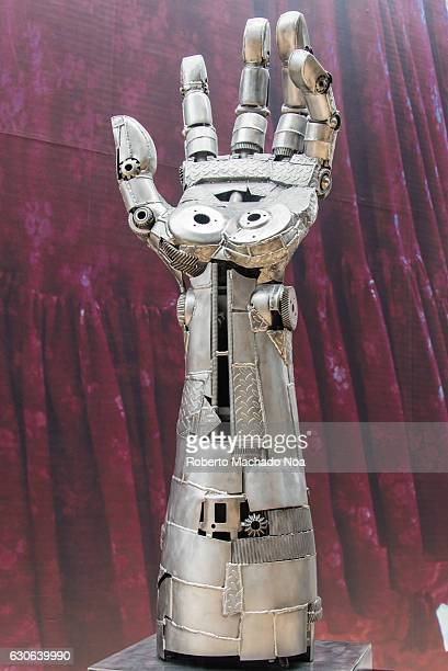 Metallic robotic arm sculpture at Yorkdale Mall or Shopping center An upright arm made out of spare metal pieces