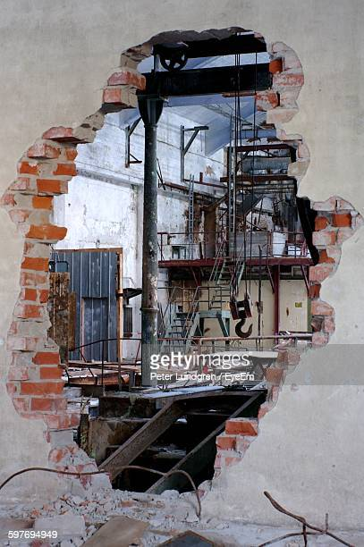 Metallic Staircase In Damaged Industry Seen Through Hole