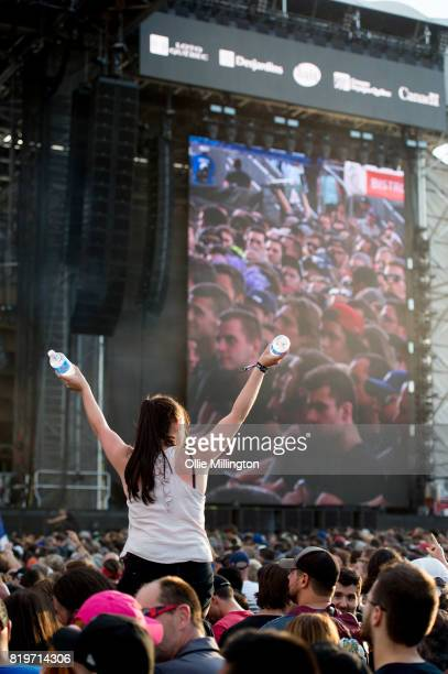 Metallica fan in the crowd on a friends shoulders on day 9 of the 50th Festival D'ete De Quebec headlined by Metallica on the Main Stage at the...