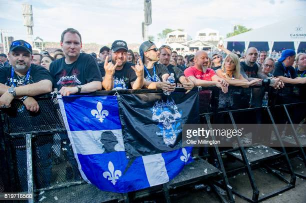 Metallica fans in the crowd front row with fan club flags on day 9 of the 50th Festival D'ete De Quebec headlined by Metallica on the Main Stage at...
