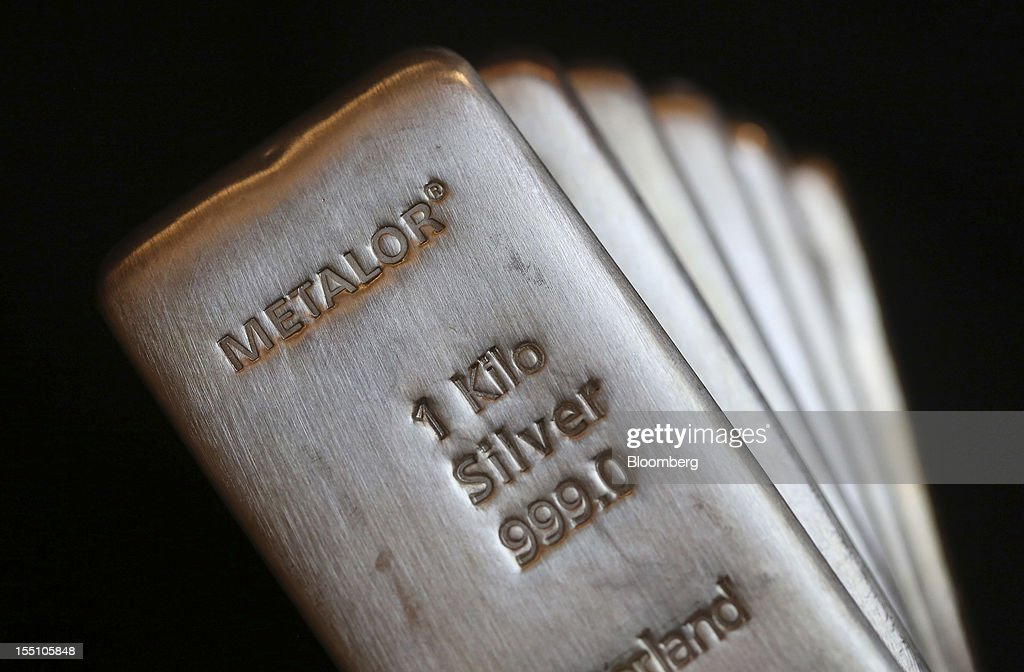 Metalor Technologies SA-branded one kilogram silver bars are seen in this arranged photograph at Gold Investments Ltd. bullion dealers in London, U.K., on Thursday, Nov. 1, 2012. Gold may rise for a third straight day, as China's manufacturing expanded for the first time in three months, increasing demand prospects for commodities. Photographer: Chris Ratcliffe/Bloomberg via Getty Images