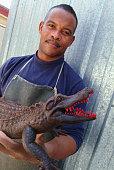 Metalworker Holding Bronze Alligator