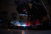 industrial metalworker while welding