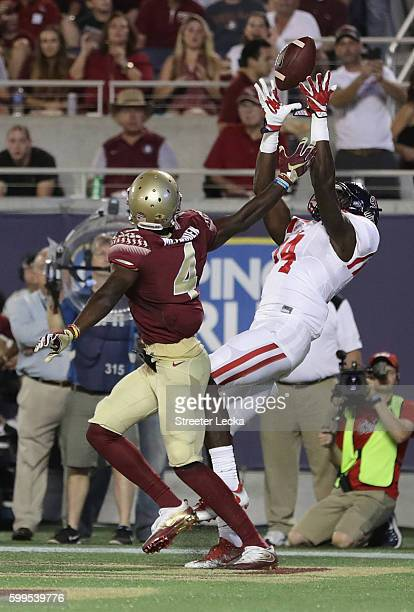 K Metcalf of the Mississippi Rebels scores a touchdown in the second quarter against the Florida State Seminoles during the Camping World Kickoff at...