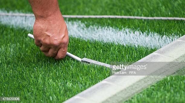 Mete Cekic of Sports Labs measures the unevenness of the turf while performing a field level test during artificial turf testing at BC Place Stadium...