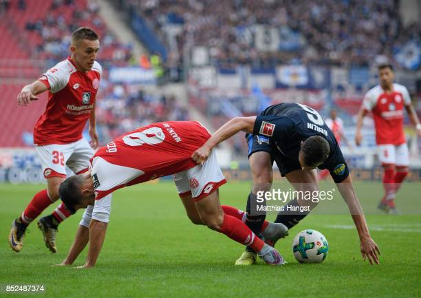 Mete Levin Oeztunali of Mainz and Vladimir Darida of Berlin compete for the ball during the Bundesliga match between 1 FSV Mainz 05 and Hertha BSC at...