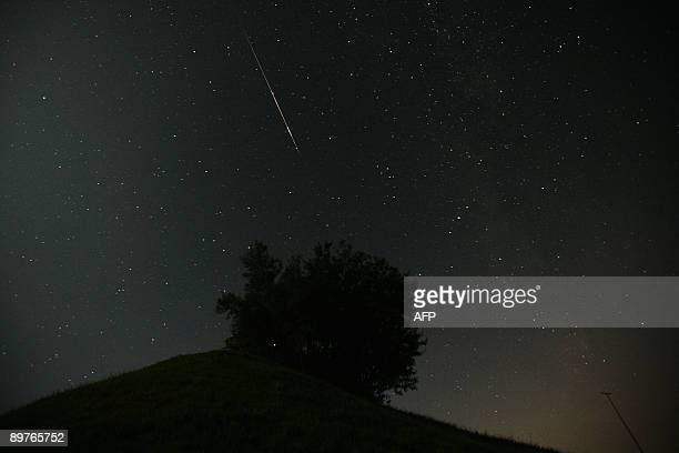 A meteor enters the earth's atmosphere during the Perseid meteor shower earlyon August 13 2009 in the northeastern village of Rotbuehl in Switzerland...