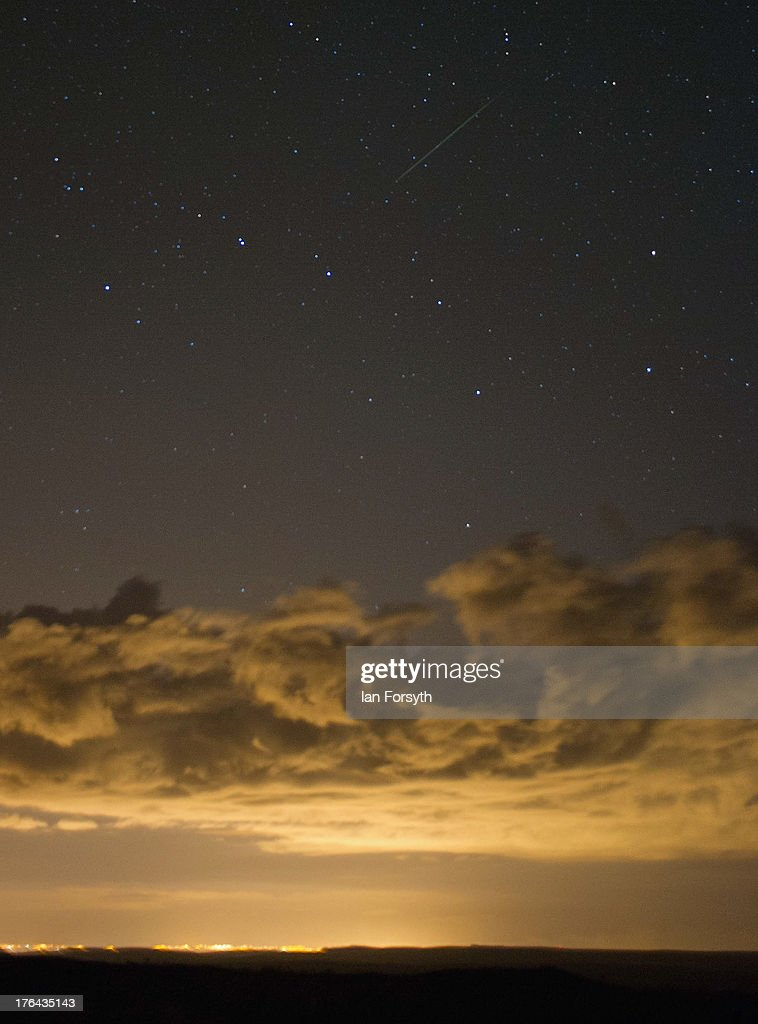 A meteor is visible as it streaks across the night sky and appearing to be above the constellation of Ursa Major on August 13, 2013 over the North Yorkshire Moors, United Kingdom. The Perseid Meteor shower is visible from mid-july each year with peak activity being between the 9th and 14th of August. During the peak, the rate of meteors can reach 60 or more per hour. They can be seen all across the sky as they gradually fall away from the tail of the Swift-Tuttle comet.