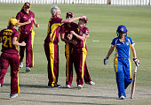 Meteor Katie Mack leaves the field after being runout during the round one WNCL match between Queensland and ACT at Allan Border Field on October 10...