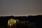 A meteor passes across the sky above Rievaulx Abbey during the peak in activity of the annual Perseids meteor shower in the village of Rievaulx near...