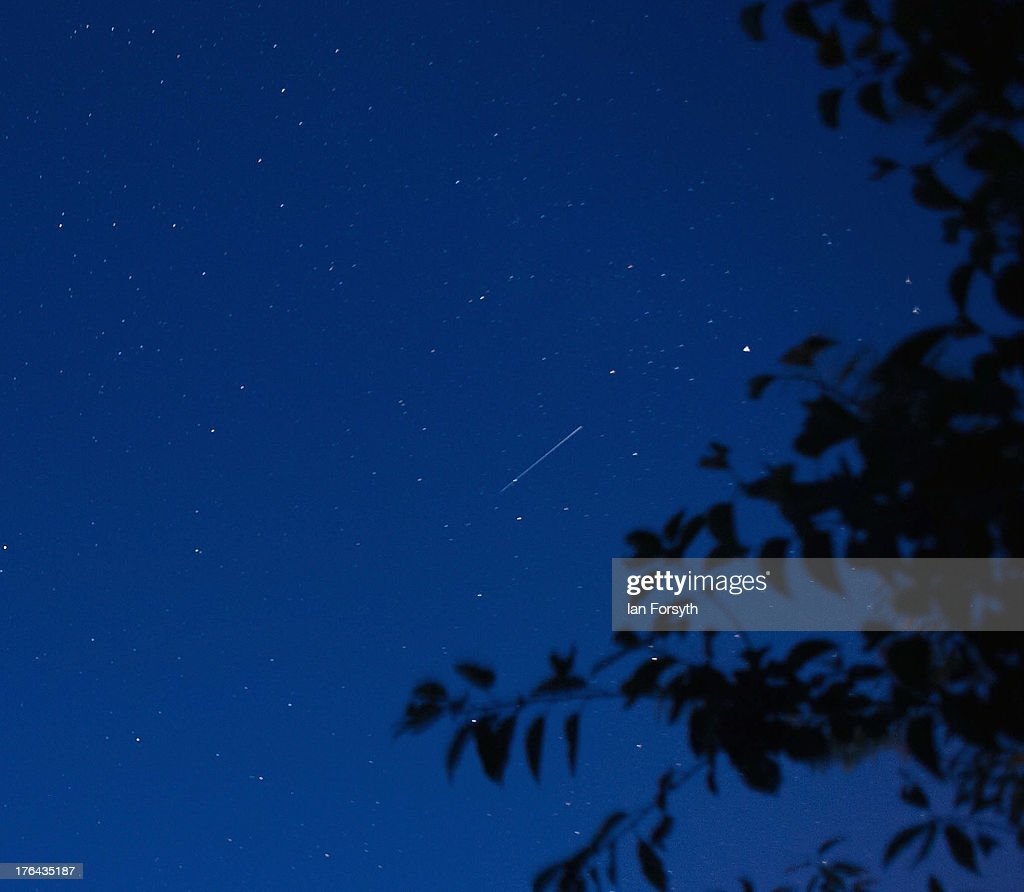 A meteor streaks across the early morning sky on August 13, 2013 over Saltburn, United Kingdom. The Perseid Meteor shower is visible from mid-july each year with peak activity being between the 9th and 14th of August. During the peak, the rate of meteors can reach 60 or more per hour. They can be seen all across the sky as they gradually fall away from the tail of the Swift-Tuttle comet.