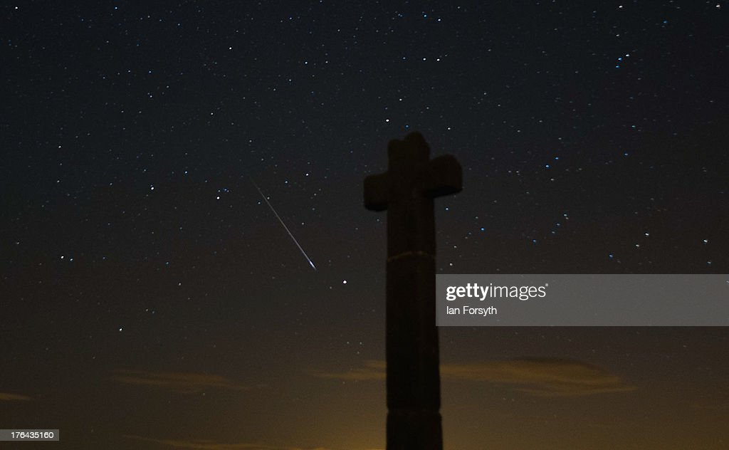 A meteor streaks across the night sky above New Ralph's Cross on August 13, 2013 on the North Yorkshire Moors, United Kingdom. The Perseid Meteor shower is visible from mid-july each year with peak activity being between the 9th and 14th of August. During the peak, the rate of meteors can reach 60 or more per hour. They can be seen all across the sky as they gradually fall away from the tail of the Swift-Tuttle comet.