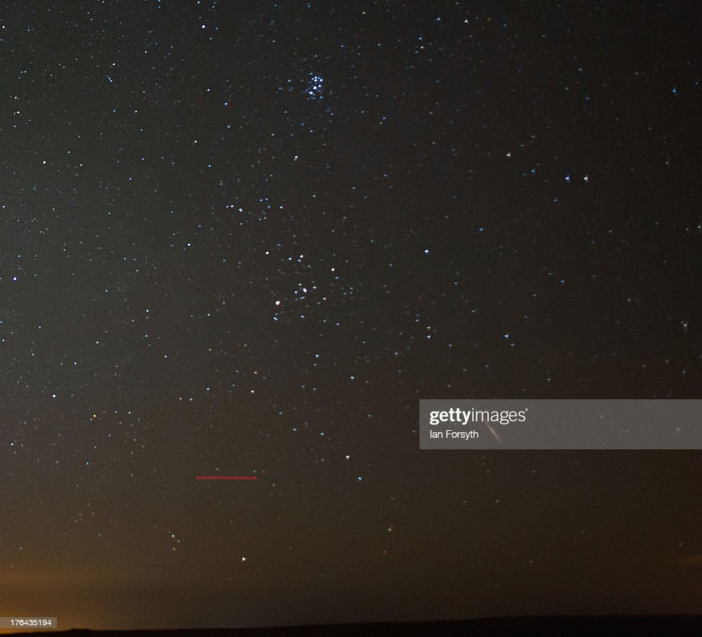 A meteor (bottom right) streaks across the night sky on August 13, 2013 over the North Yorkshire Moors, United Kingdom. A commercial aircraft (bottom left) can also be seen as can the constellation of Pleiades (top). The Perseid Meteor shower is visible from mid-july each year with peak activity being between the 9th and 14th of August. During the peak, the rate of meteors can reach 60 or more per hour. They can be seen all across the sky as they gradually fall away from the tail of the Swift-Tuttle comet.