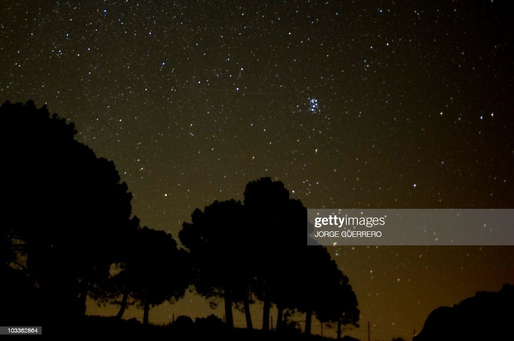 A meteor streaks across the sky against a field of stars during a meteorite shower early August 13, 2010 near Grazalema, southern Spain. AFP PHOTO/ JORGE GUERRERO.