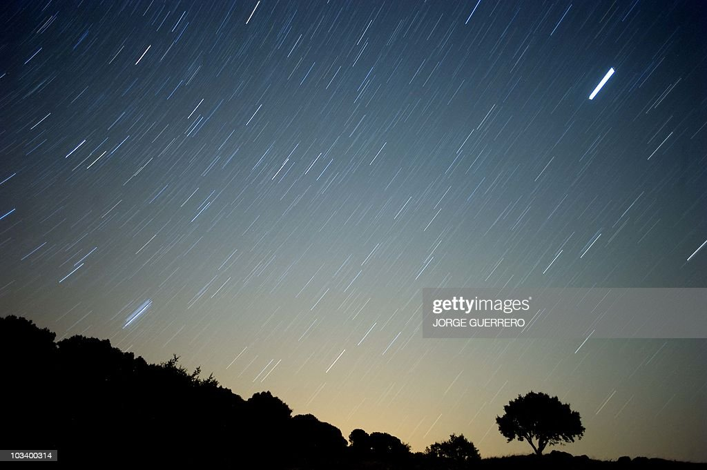 A meteor streaks across the sky against a field of stars during a meteorite shower early August 13 2010 near Grazalema southern Spain AFP PHOTO/...