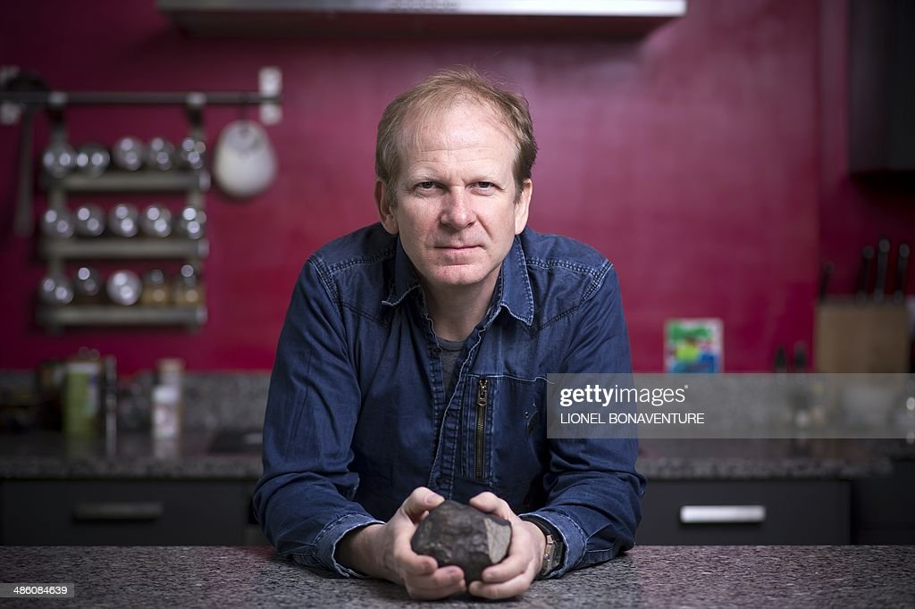 Meteorite hunter and collector Luc Labenne poses in Paris on April 8, 2014. AFP PHOTO / LIONEL BONAVENTURE