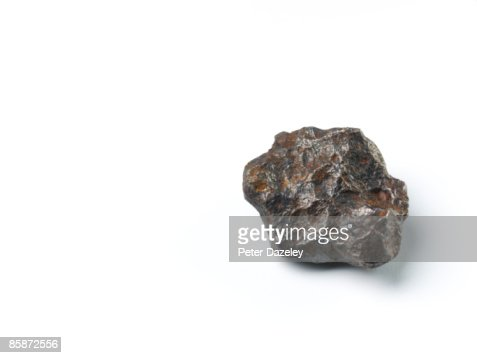 Meteorite on white background.