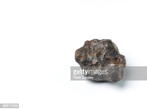 Meteorite on white background.