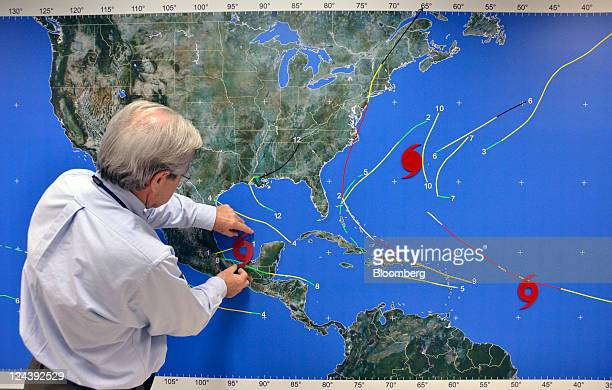 Meteorologist Dennis Feltgen places the tropical storm symbol on Tropical Storm Nate on a tracking map at the National Weather Service's National...