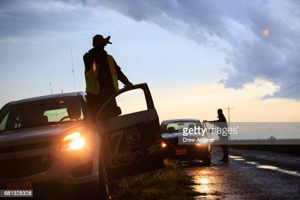 Meteorologist Nicholas Stewart and Robin Duspara who traveled to the US from Prague and runs the Czech Thunderstorm Research Association pull over...