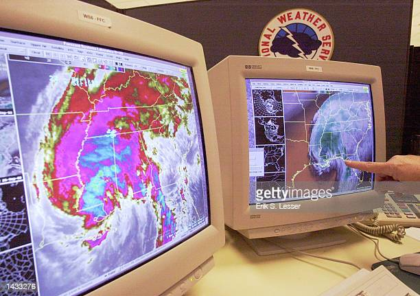 A meteorologist with the National Weather Service tracks the progress of Tropical Storm Isidore September 26 2002 in Peachtree City Georgia The...