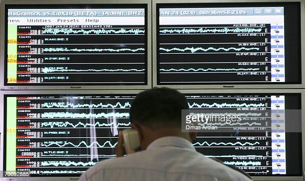 Meteorology and Geophysics Agency officer monitors a screen graphic at the BMG office of a 65magnitude earthquake that struck North Sulawesi province...