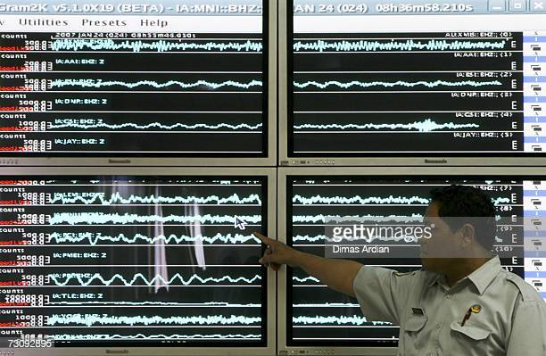 Meteorology and Geophysics Agency officer points to a screen graphic at the BMG office of a 65magnitude earthquake that struck North Sulawesi...