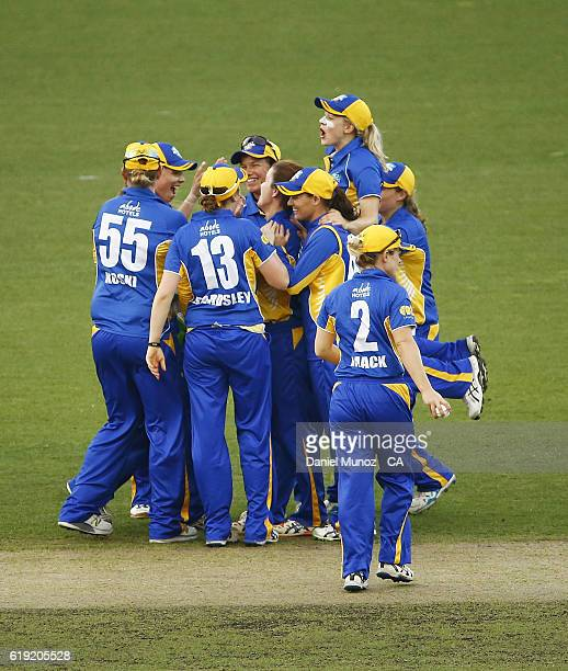 Meteors celebrate after taking the wicket of Tegan McPharlin of the Scorpions during the WNCL match between ACT and South Australia at Manuka Oval on...