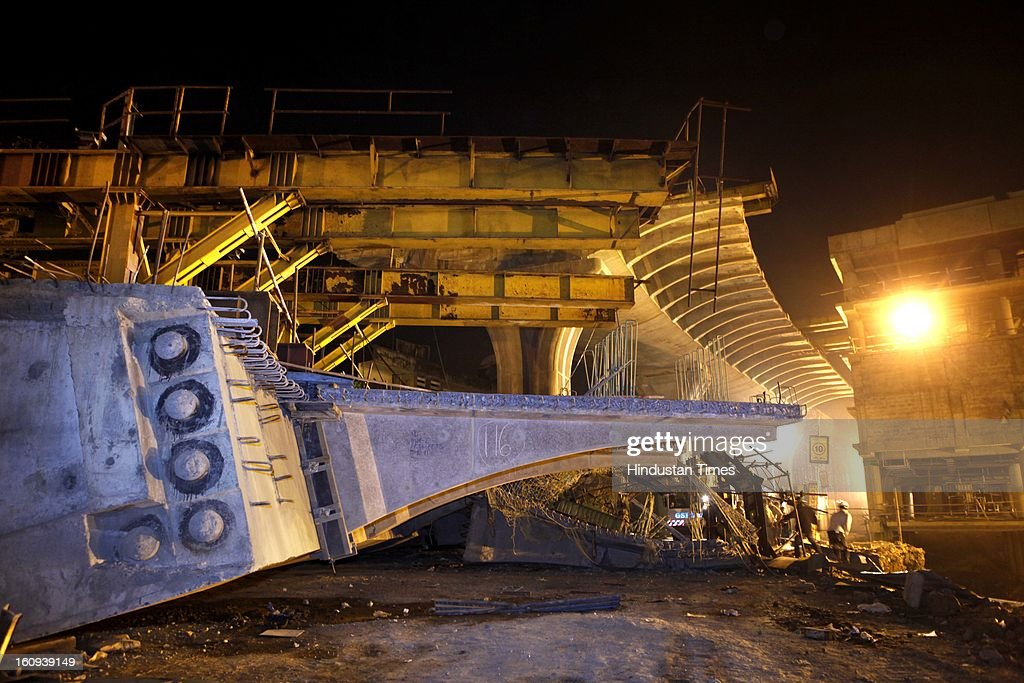 A 35 meter long slab, part of the Sahar elevated corridor collapsed while it was being mounted late on Wednesday night, on February 7, 2013 in Mumbai, India. According to fire officials, three bodies were removed and five people have been rescued from the debris and rushed to Holy Spirit and Cooper hospital.