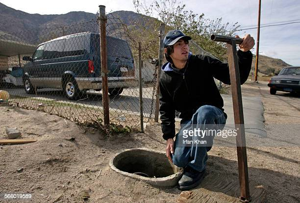 Meter reader Kevin Tucker busts an illegal water connection at a residence after Cabazon Water District disconnected water for non payment of bill