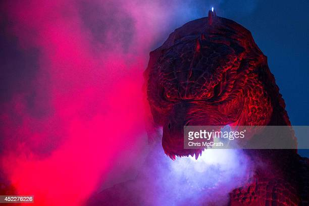 A 66 meter replica Godzilla is lit up during a press preview at Tokyo Midtown on July 17 2014 in Tokyo Japan The 'MIDTOWN Meets GODZILLA' project is...