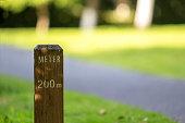 meter stake beside greenway in park