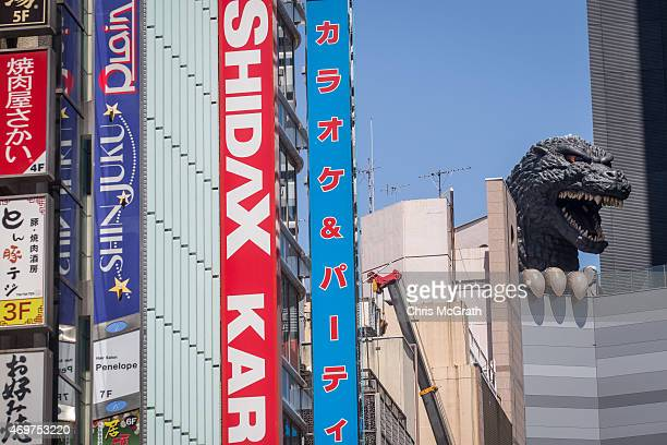 A 12 meter tall Godzilla replica head is seen on the 8th floor terrace of the Hotel Gracery Shinjuku on April 15 2015 in Tokyo Japan The Godzilla...