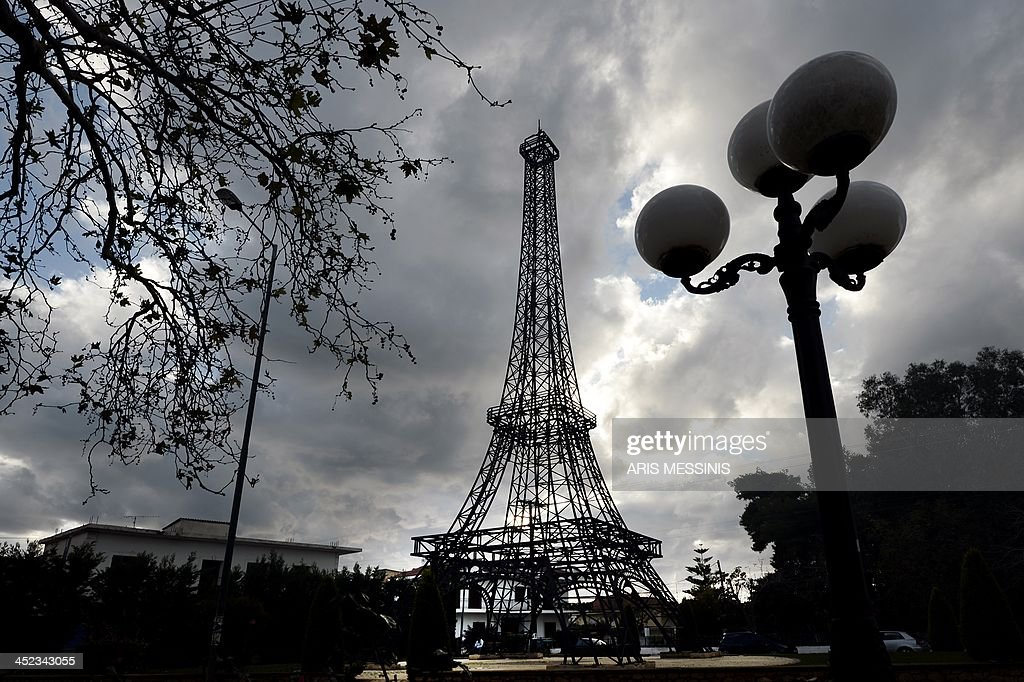 A 26 meters hight replica of the Eiffel tower made by Greek doctor and sculptor Harris Fournarakis stands at a square of the entrance of Filiatra village, some 280 kilometers south west of of Athens on November 27, 2013.