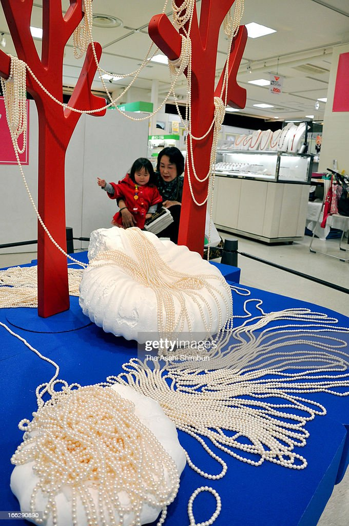 222 meters long pearl necklace is displayed at Hanshin Department Store on April 10, 2013 in Osaka, Japan. The World's longest necklace, used 27,750 pearls and 20.2 kilogram weight, is made by the Tourism Association of Shima City, the birthplace of pearl farming, as a promotion.
